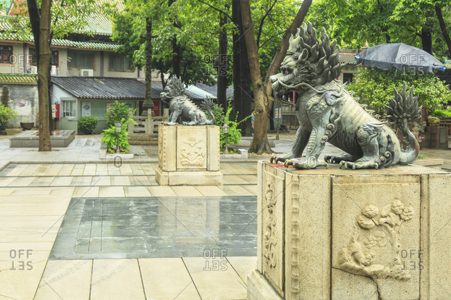 Side view of lion statues on plinths, Foshan Ancestral Temple, Foshan, China