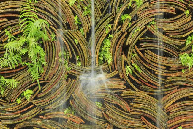 Tiles stacked behind waterfall, Nanfeng Kiln, Foshan, China