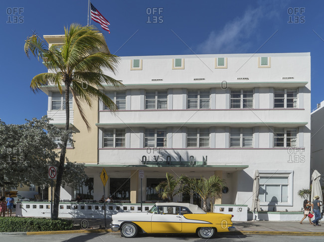 Vintage car parked in from of an Art Deco hotel in Ocean Drive, Miami Beach, Florida, USA