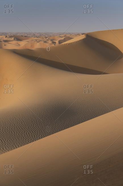 Sand dunes in the Empty Quarter Desert, between Saudi Arabia and Abu Dhabi, UAE