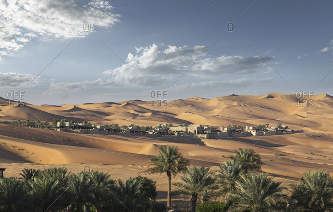 Distant view of Qsar Al Sarab desert resort among sand dunes, Empty Quarter Desert, Abu Dhabi, United Arab Emirate