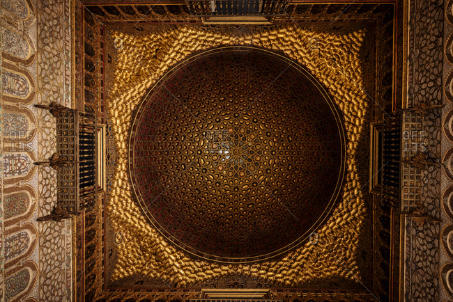 Intricately carved wooden ceiling of The Alcazar of Seville, Seville, Andalucia, Spain
