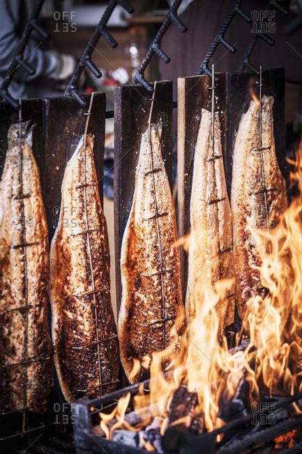 Fish cooking on open fire in street market, Basel, Switzerland