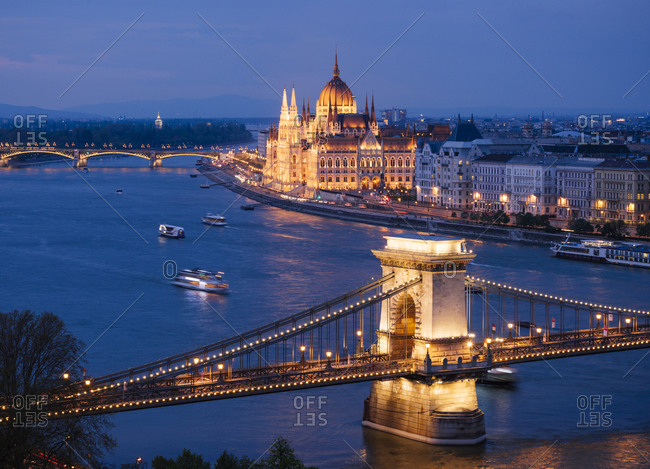 View over River Danube, Chain Bridge and Hungarian Parliament Building at night, Budapest, Hungary