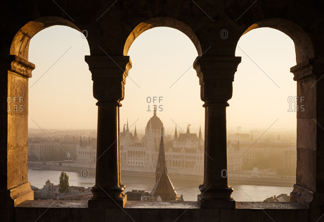 View from Fishermans Bastion over Danube River & Hungarian Parliament Building at dawn, Budapest, Hungary