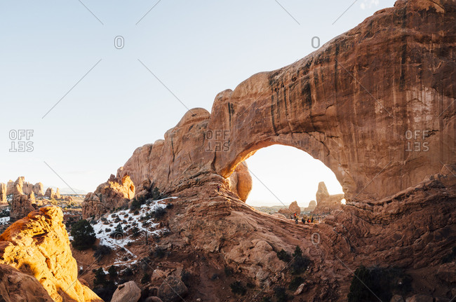 Tourists at arched rock formation, Moab, Utah, USA