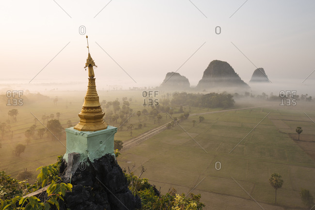 Misty mountains and Kaw Gon Pagoda, Hsipaw, Shan State, Myanmar
