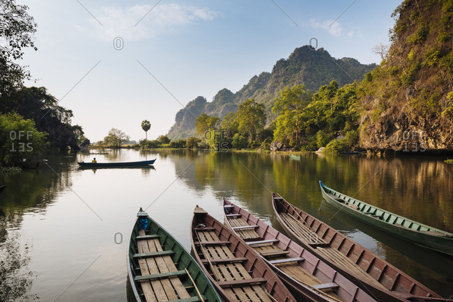 Boats moored on water, Sa-dan Cave, Hsipaw, Shan State, Myanmar