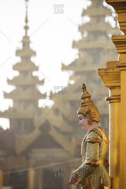 Statue at buddhist temple, Shwedagon Pagoda, Yangon, Myanmar