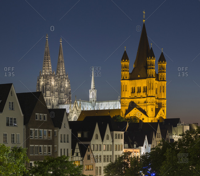Cityscape with Great St Martin Church and Cologne Cathedral (Koelner Dom) at night, Cologne, Germany
