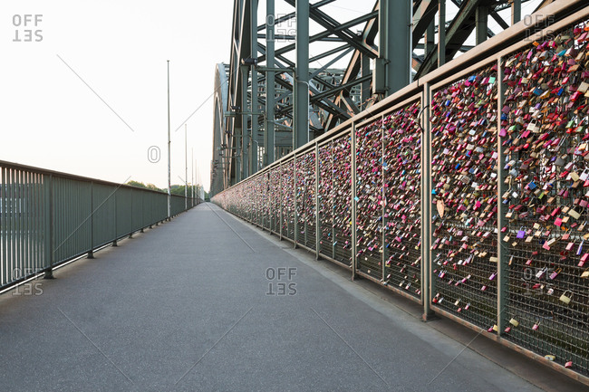 Abundant display of love locks attached to Hohenzollern Bridge fence, Cologne, Germany