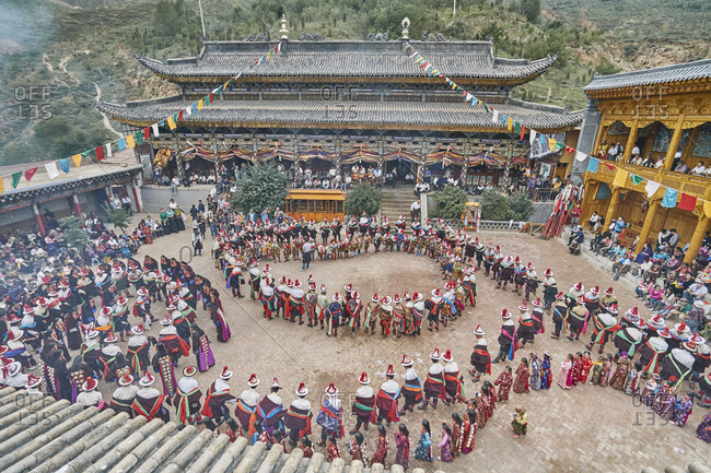 Traditional village celebration of flower blossom, Tongren, Qinghai Province, China
