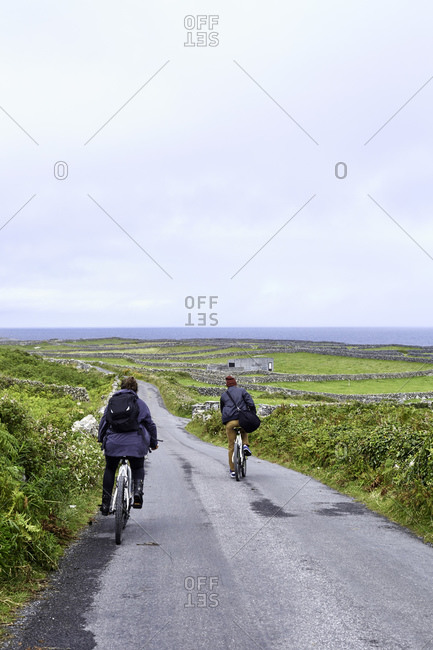 Cyclists on road, Inishmore, Ireland