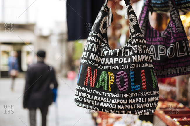 Napoli shoulder bags on tourist market stall, Naples, Campania, Italy