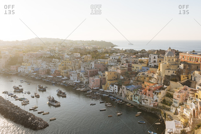 Elevated view of waterfront and buildings at dusk, Procida island, Campania, Italy