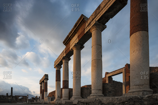 Remains of columns at dusk, Pompeii, Campania, Italy