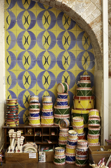 Wooden crafted products display, tiled wall background, Lisbon, Portugal