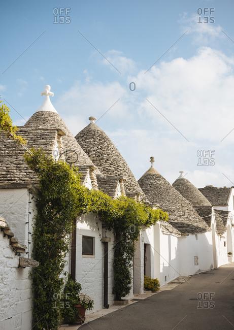 Row of whitewashed trullo houses, Alberobello, Puglia, Italy