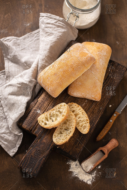 Top view of sliced Italian ciabatta on cutting board