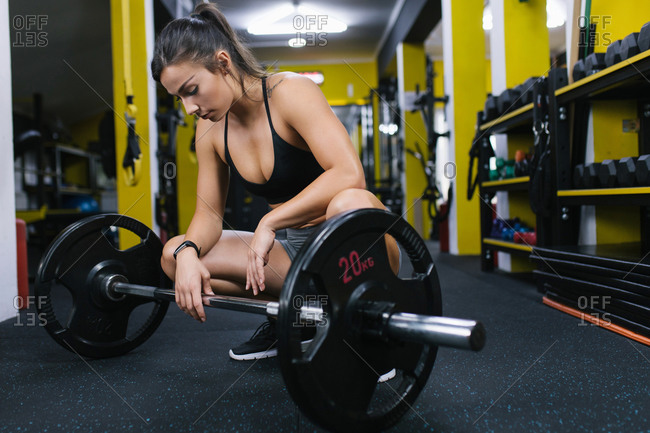 Tired female athlete at the gym