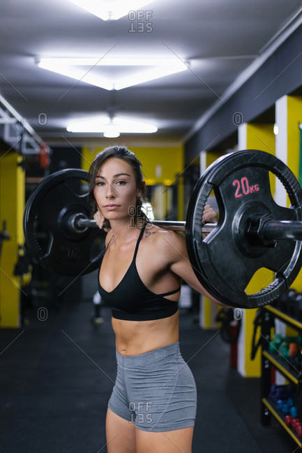 Female athlete lifting weight at the gym