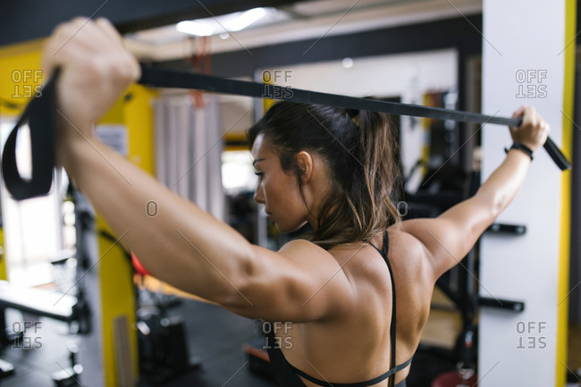 Female working out with resistance band at gym
