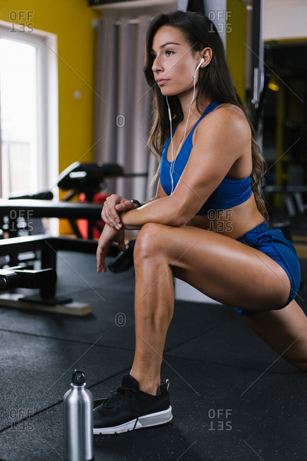Beautiful woman warming up for exercise in the gym