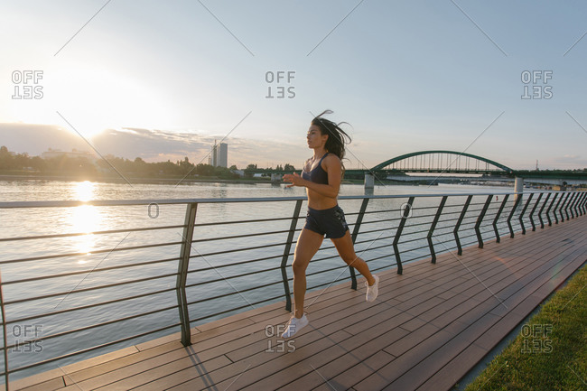 Woman running in the city next to the river