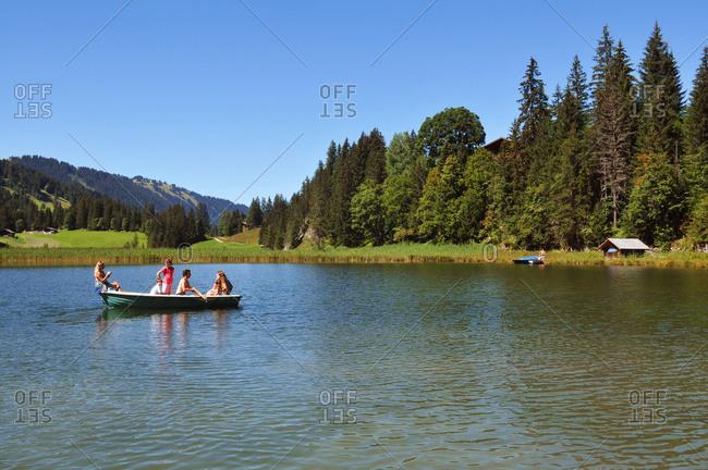Switzerland - August 24, 2017: Switzerland, Bern canton, Hight-Simmental region, Pastures on Wispile, hiking to Lauenen valley and lake