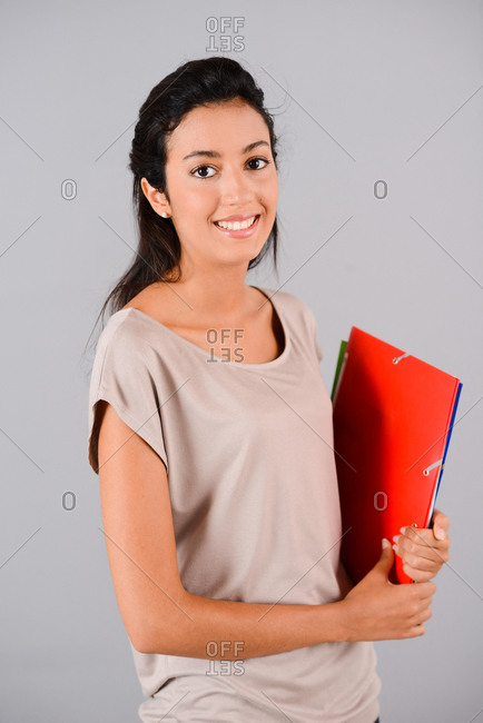 isolated studio shot of a cheerful young student girl smiling