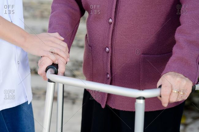 Elderly senior woman with a nurse hands detail