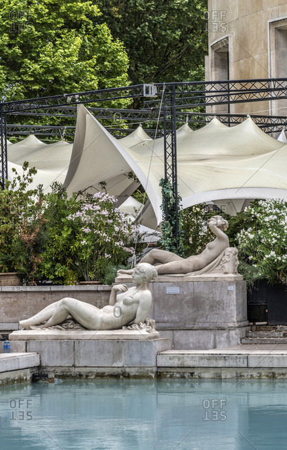 """France - July 22, 2017: France, 16th arrondissement of Paris, Palais de Tokyo, veils of the """"Monsieur Bleu"""" restaurant and statues by the reflecting pool"""