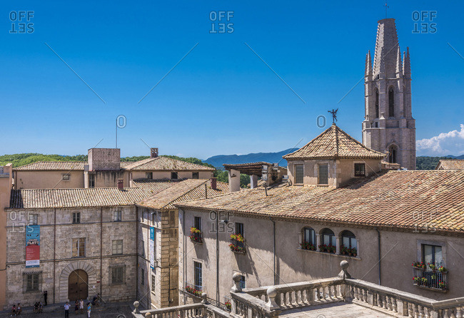 Spain - June 24, 2016: Spain, Catalonia, Girona, bell tower of the church of St. Felix seen from the stairs of the Girona cathedral
