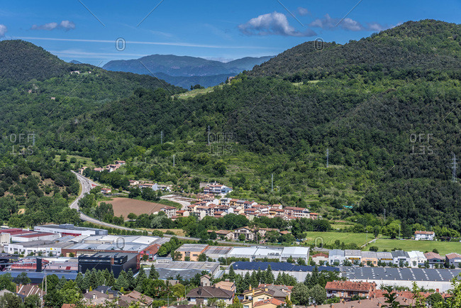 Spain, Catalonia, Garrotxa Volcanic Zone Natural Park, Olot, extinct volcanos, activity center and residential buildings