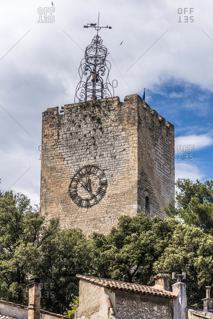France, Provence-Alpes-Cote d'Azur, Vaucluse, Pernes-les-Fontaines, bell tower (12th century), wrought iron steeple (18th century) and a weather vane with a cat chasing a mouse.