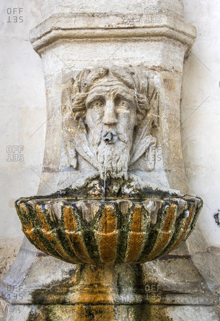 France - June 6, 2017: France, Provence-Alpes-Cote d'Azur, Vaucluse, Pernes-les-Fontaines, details of the fountain of the garden of the city hall (or the garden of the angel)