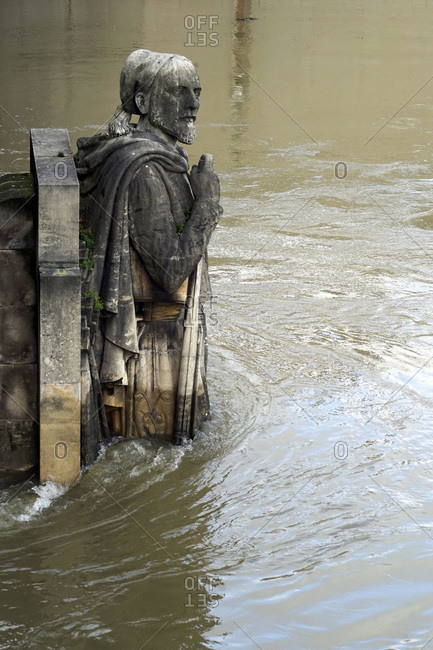 France - January 27, 2018: Europe, France, Ile de France, Paris, the Seine overflowing in January 2018. The Zouave half-submerged by floodwaters, seen from the Pont de l'Alma.