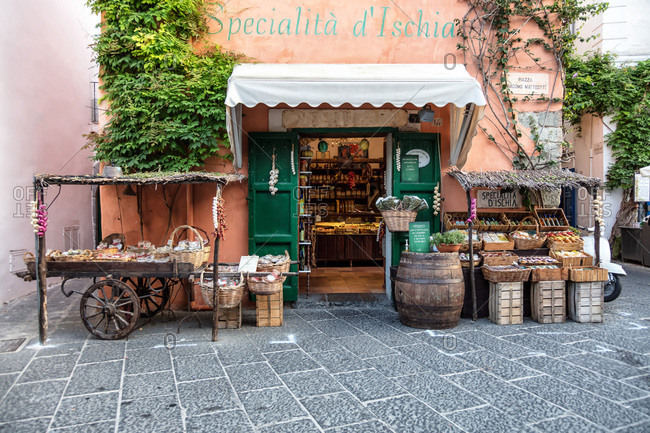 Italy - August 10, 2017: View of a quaint Italian grocery store in an alley, Ischia, Gulf of Naples, Italy
