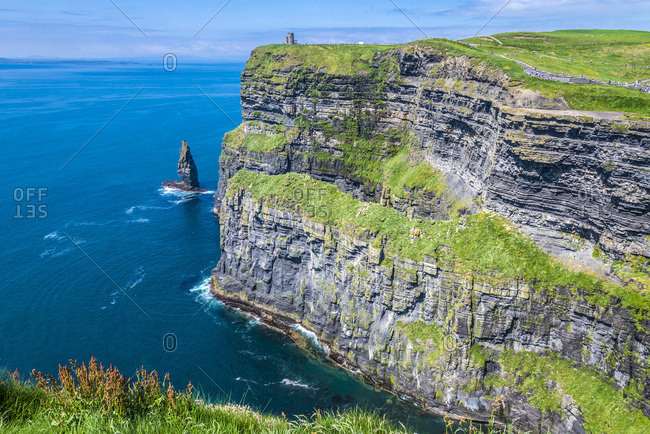 Europe, Republic of Ireland, Clare County, Burren and Cliffs of Moher Geopark (UNESCO World Heritage), North cliffs and rocky outcrop caused by sea erosion, seen from the South cliffs