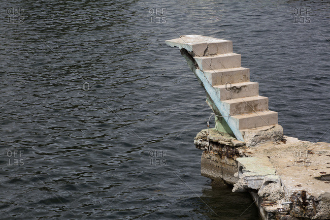 Concrete staircase built to allow access to a swimming pool located just above the sea but the project was abandoned, Santiago de Cuba, Cuba
