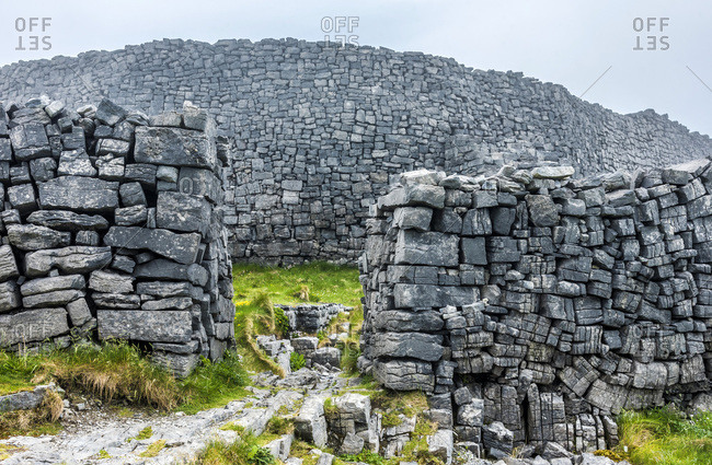 Europe, Republic of Ireland, County Galway, Aran Islands, Inishmore Island, cliffs dug by the sea near the Dun Aengus prehistorical Ringfort site (1100 BC - 800 AC) (National Monument)