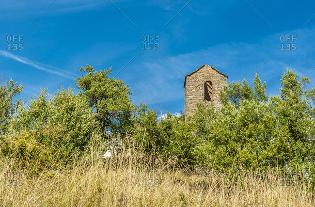 Spain, autonomous community of Aragon, Sierra y Canons de Guara natural park, plateau of the Mascun Canyon, abandonned village of Otin, bell tower of the church in ruins