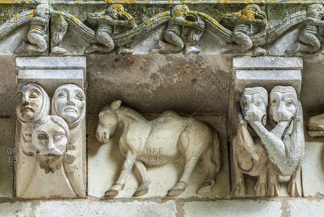 France, Charente Maritime, Surgeres, church of Notre Dame, bas-relief and corbels of the facade