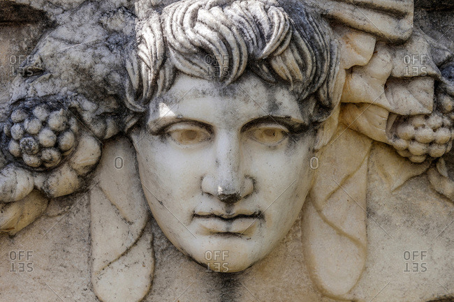 Turkey, Aphrodisias archeological Roman site, capital representing the head of a young man (UNESCO World Heritage)