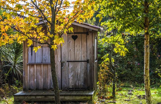 France, Gironde, hut in a garden in autumn