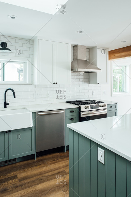 Modern farmhouse kitchen with sage green cabinets