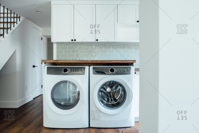 Custom laundry area with washer and dryer