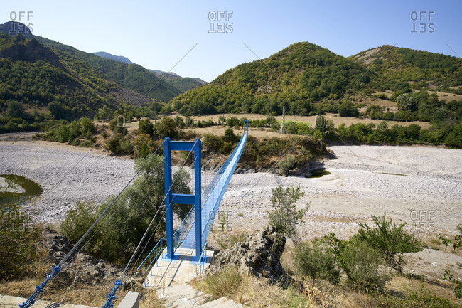 Bird's eye view over the blue rope bridge to the abandoned village of Tikva in the Borovitsa River valley, Eastern Rhodopes, Bulgaria