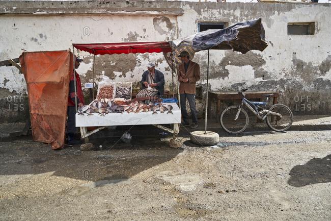Essaouira, Morocco - November 8 2017: Fish vendor at the market near the Port of Essaouira