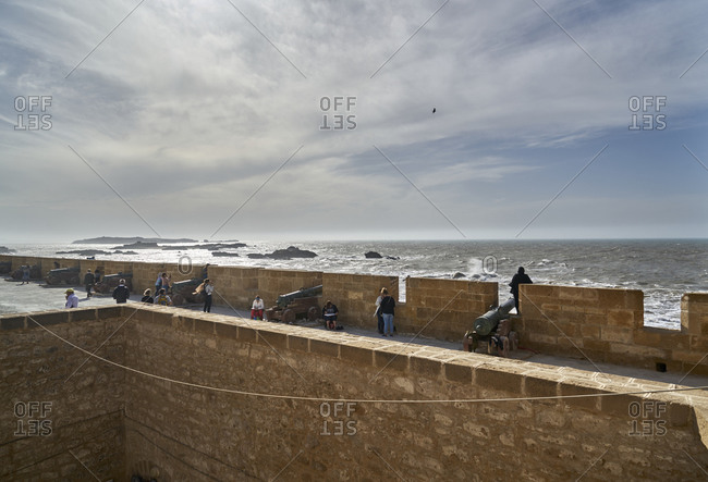 Essaouira, Morocco - November 8 2017: Tourists and cannons on top of Castelo Real of Mogador